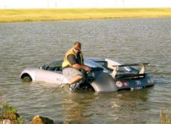 man drives bugatti veyron into a lake