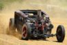off road rat rod kicking up some dirt