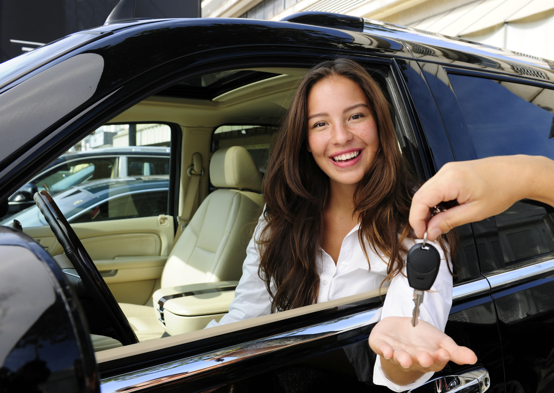 businesswoman receiving keys of her new car
