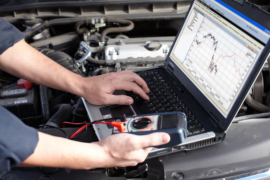 bigstock-Professional-car-mechanic-work-39017242