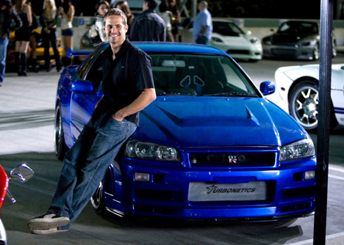 "Paul Walker relaxes against his Skyline. It was used in ""The Fast and the Furious 4."""