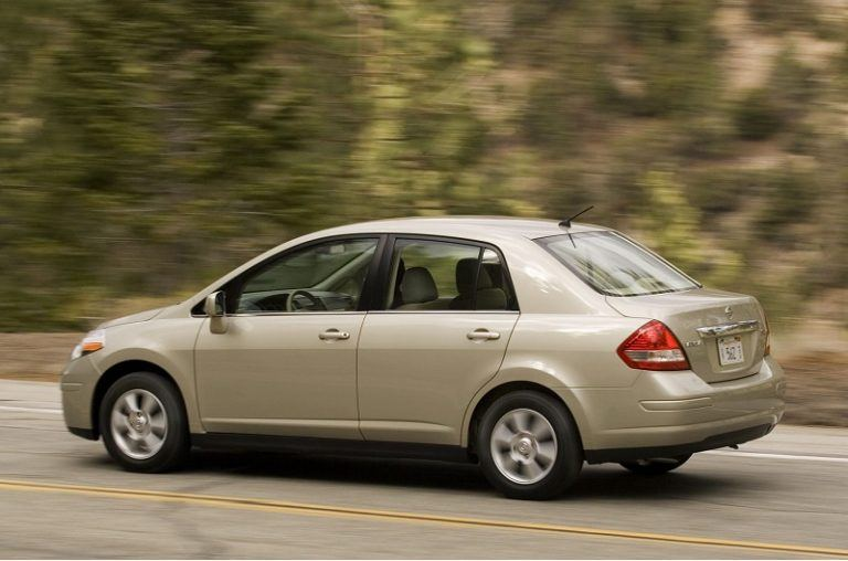 A gold Nissan Versa - Third of the deadliest Cars