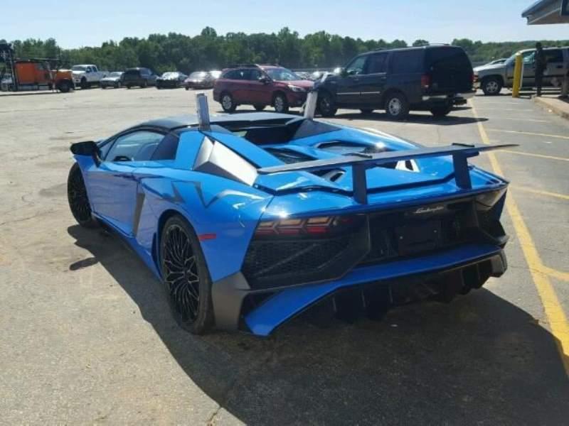 Wrecked Lamborghini Aventador SV Roadster rear 3/4 driver