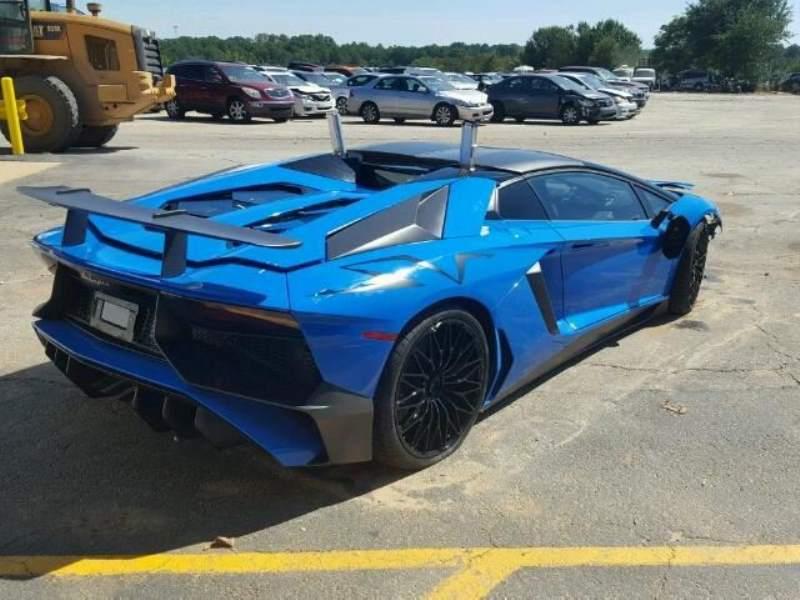 Wrecked Lamborghini Aventador SV Roadster rear 3/4 passenger