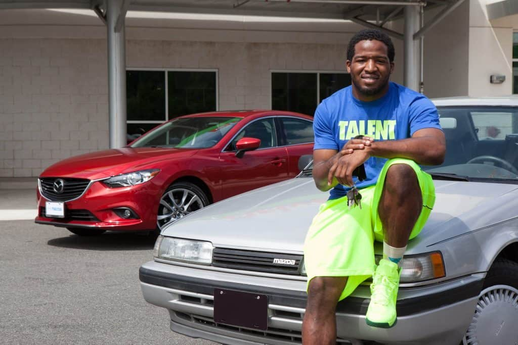 Alfred Morris and his 1991 Mazda 626, which is  one of the cheapest and best beater cars out there