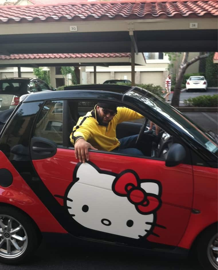 Antonio Garay and his 2008 Smart ForTwo Hello Kitty edition