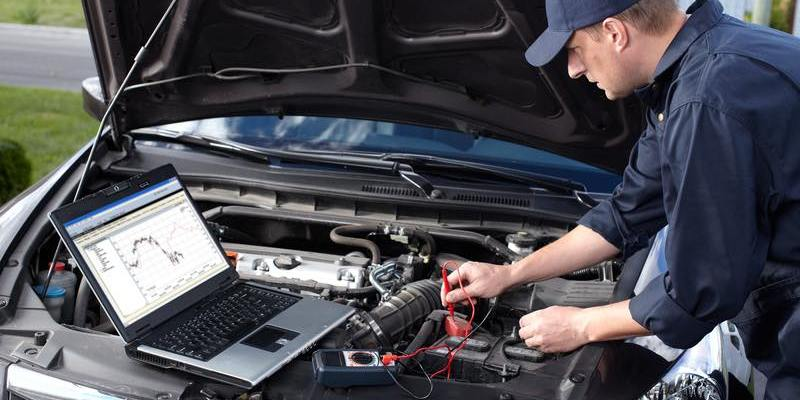 mechanic runs diagnostics