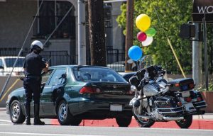 Cop sites driver with balloons due to strange traffic laws