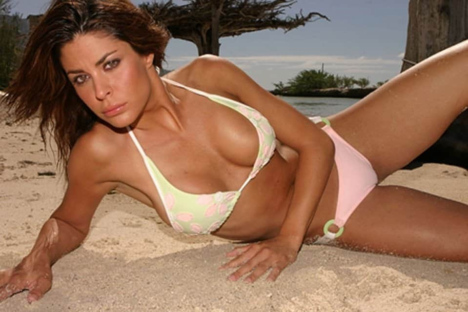 Hot car girls look good on the sand.
