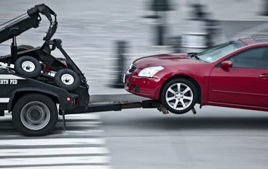 Repossession - car on tow truck