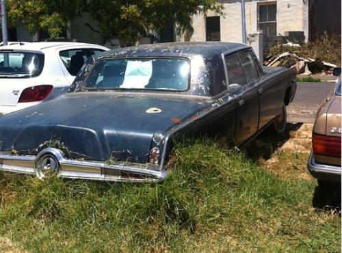 Broken down car in grass