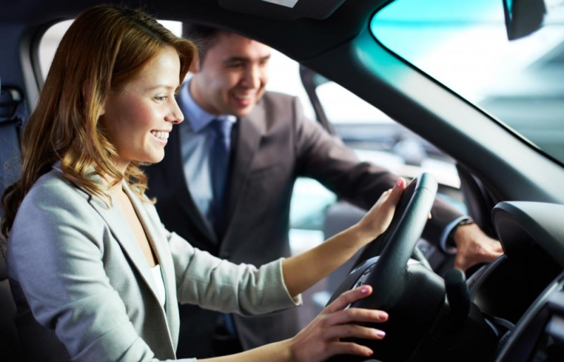 rebates and incentives - woman sitting in car