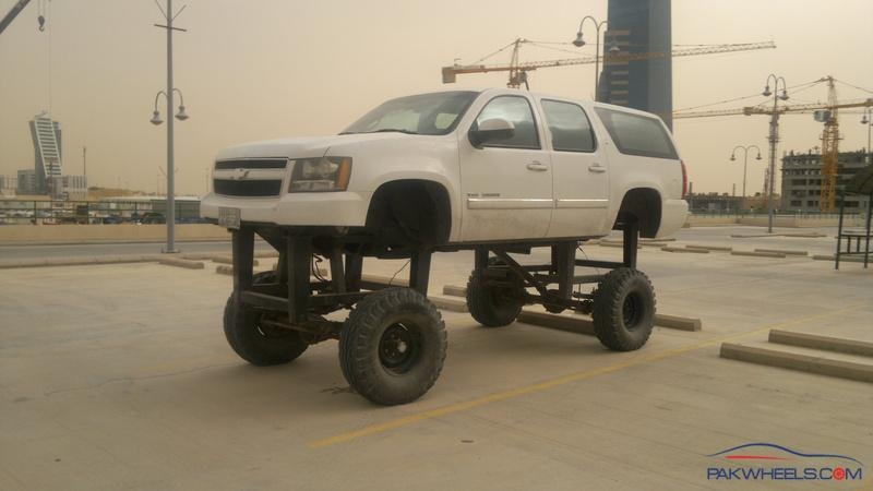 lifted suburban with small tires
